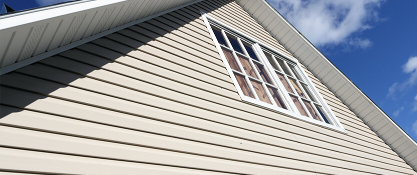 home siding on cape cod house with windows and roof line